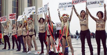 Members of FEMEN toting signs with slogans such as 'Muslim women let's get naked' and 'nudity is freedom'.