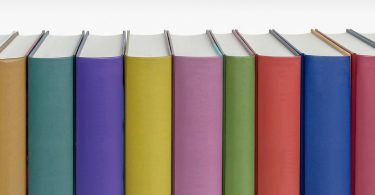 A row of book spines with no titles, books, cover, Kettle Mag, Alison Edwards